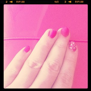 Pink nails and planner